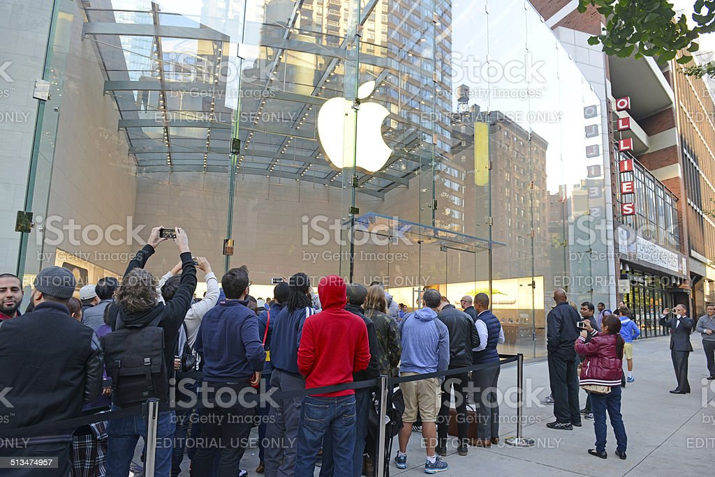 Customers on line outside the Apple Store in NYC stock photo
