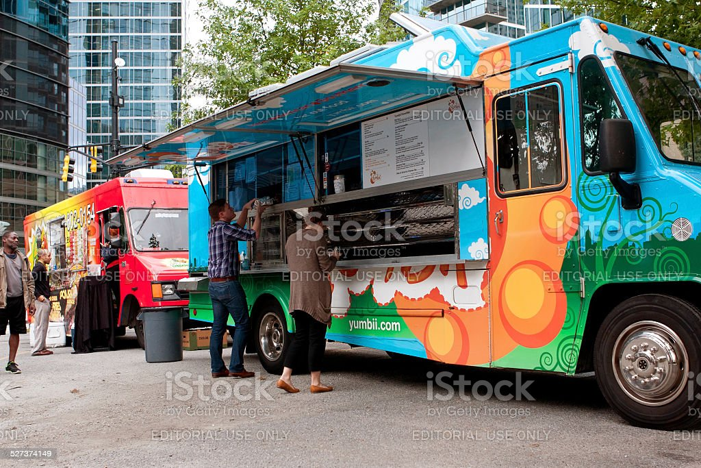 Customers Order Meals From Colorful Atlanta Food Truck stock photo