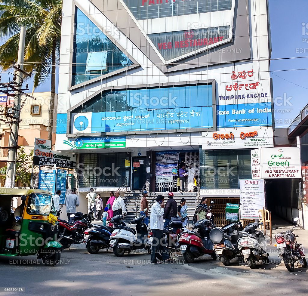 Customers outside SBI bank branch, Bangalore, India stock photo