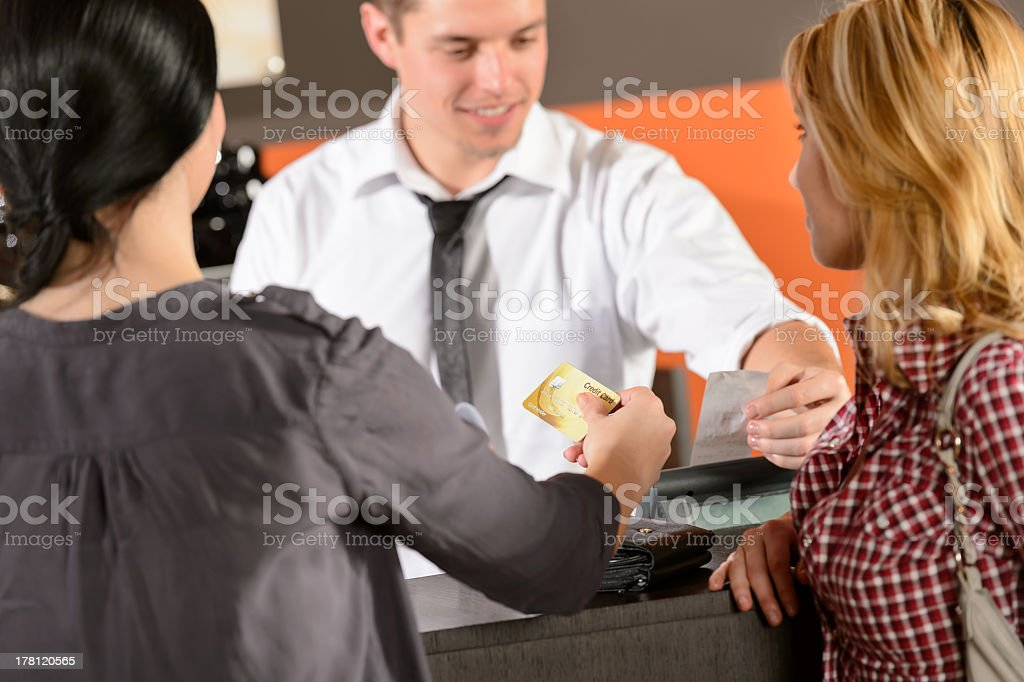 Customers paying by credit card in pub royalty-free stock photo