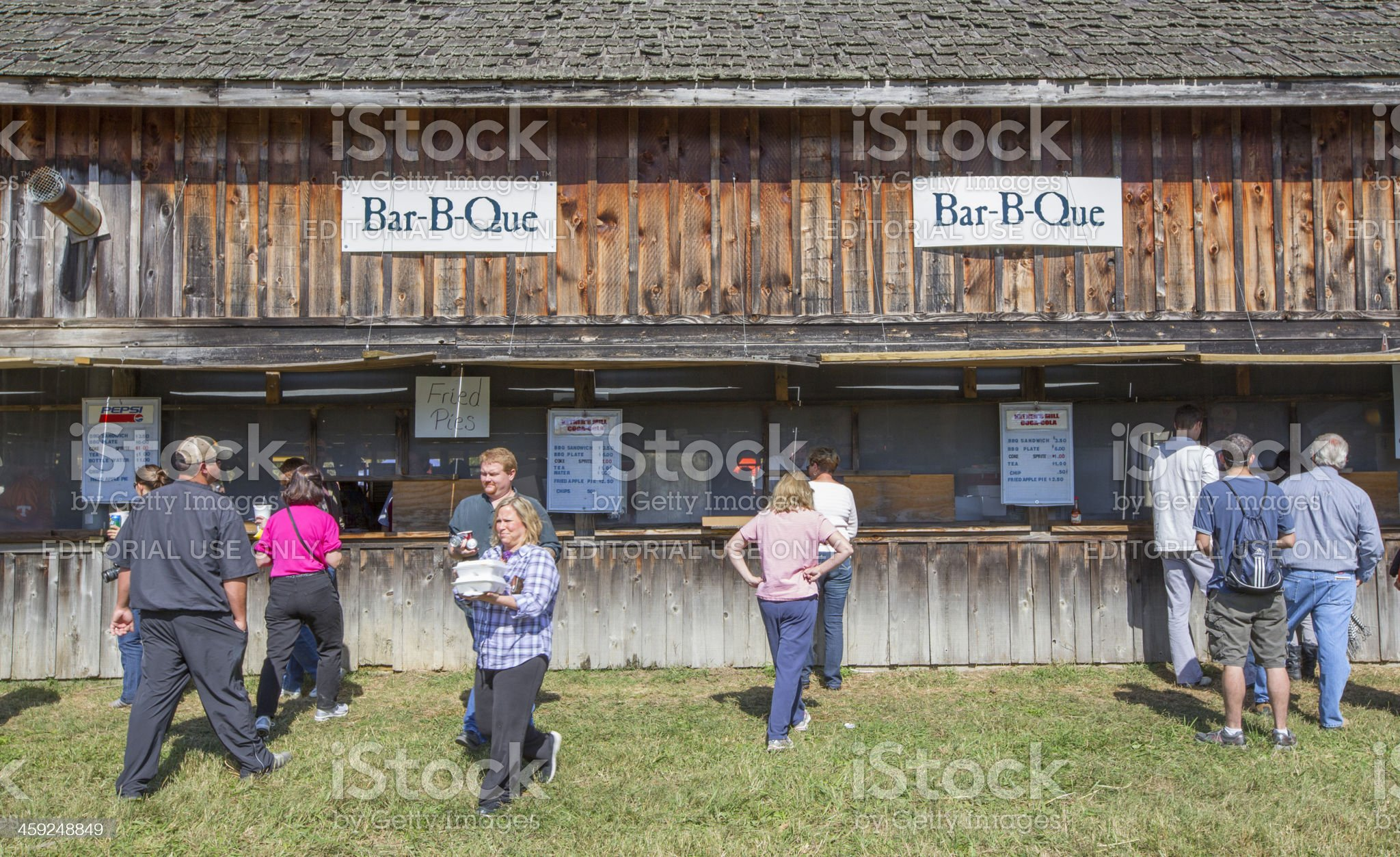 Customers Purchasing Southern Bar-B-Que at Outdoor Food Stand royalty-free stock photo