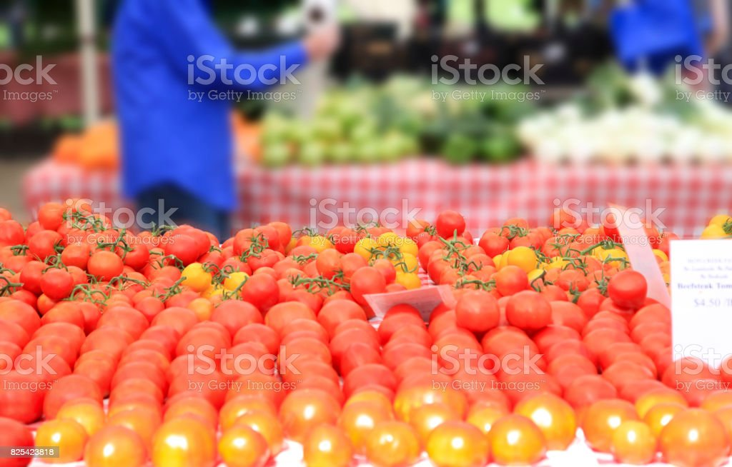 Customers Shop for Tomatoes stock photo