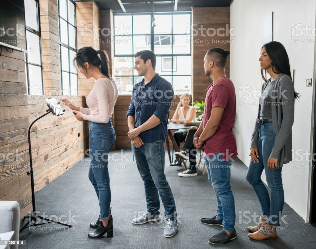 Customers taking a number at an office stock photo