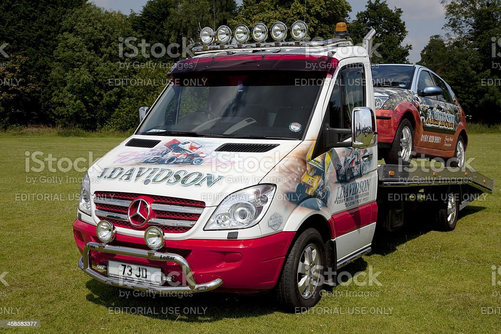Customised Mercedes flatbed truck with car stock photo