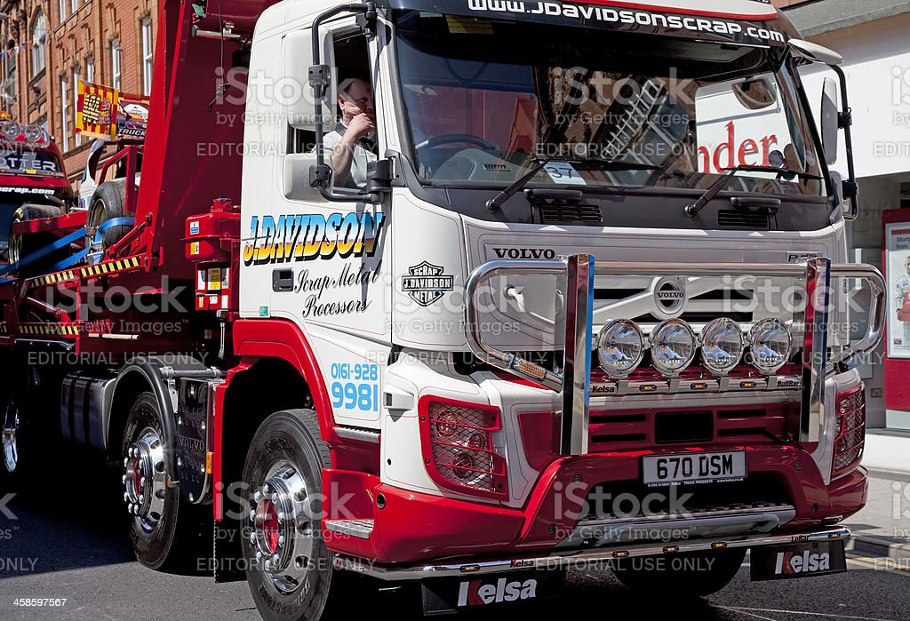 Customised Volvo flatbed truck with stock car stock photo