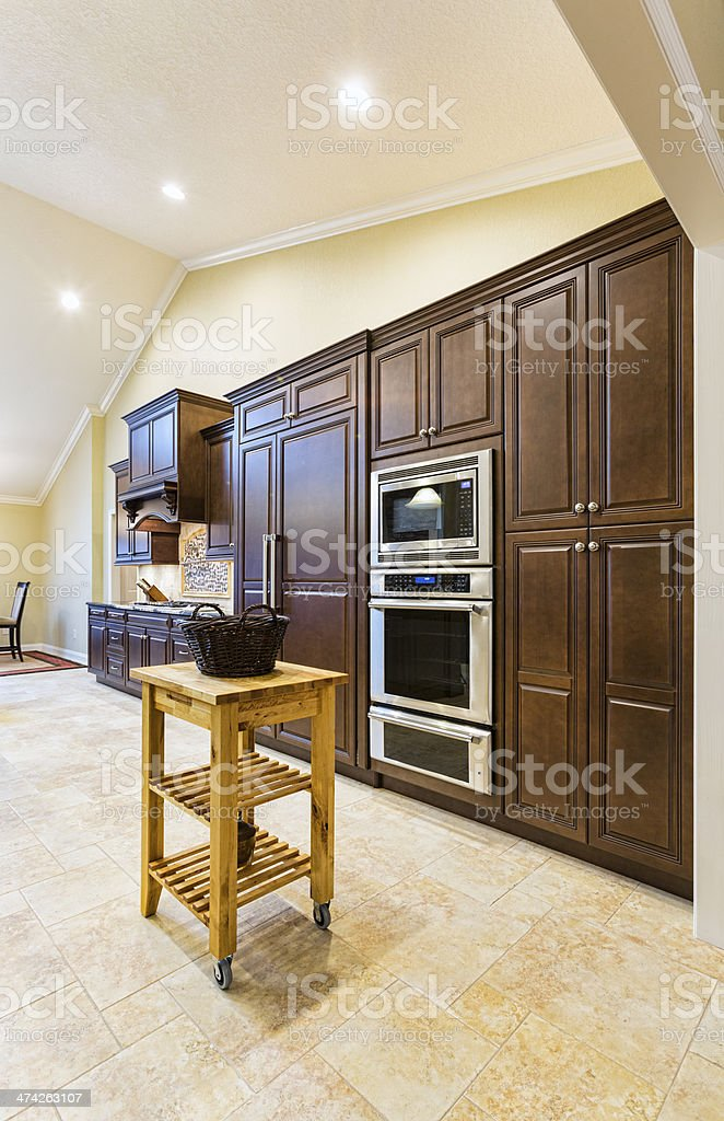 Customized kitchen with dark wood royalty-free stock photo