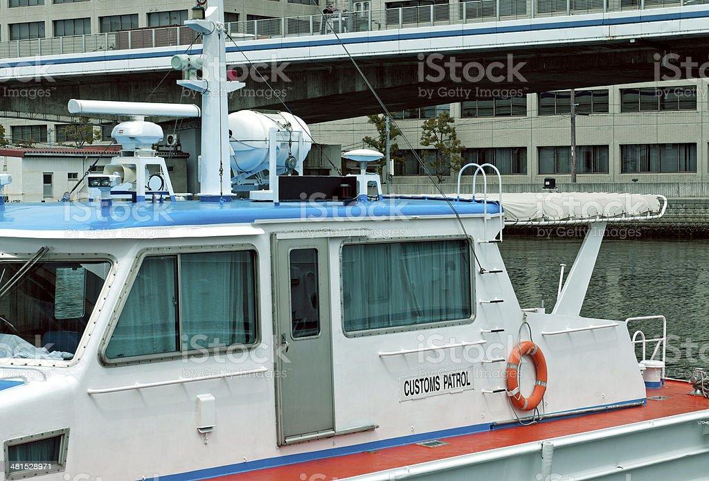 Customs patrol boat moored in harbor at Kobe JPN stock photo