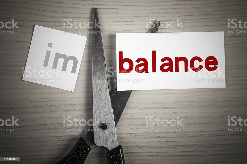 Cut balance from imbalance stock photo