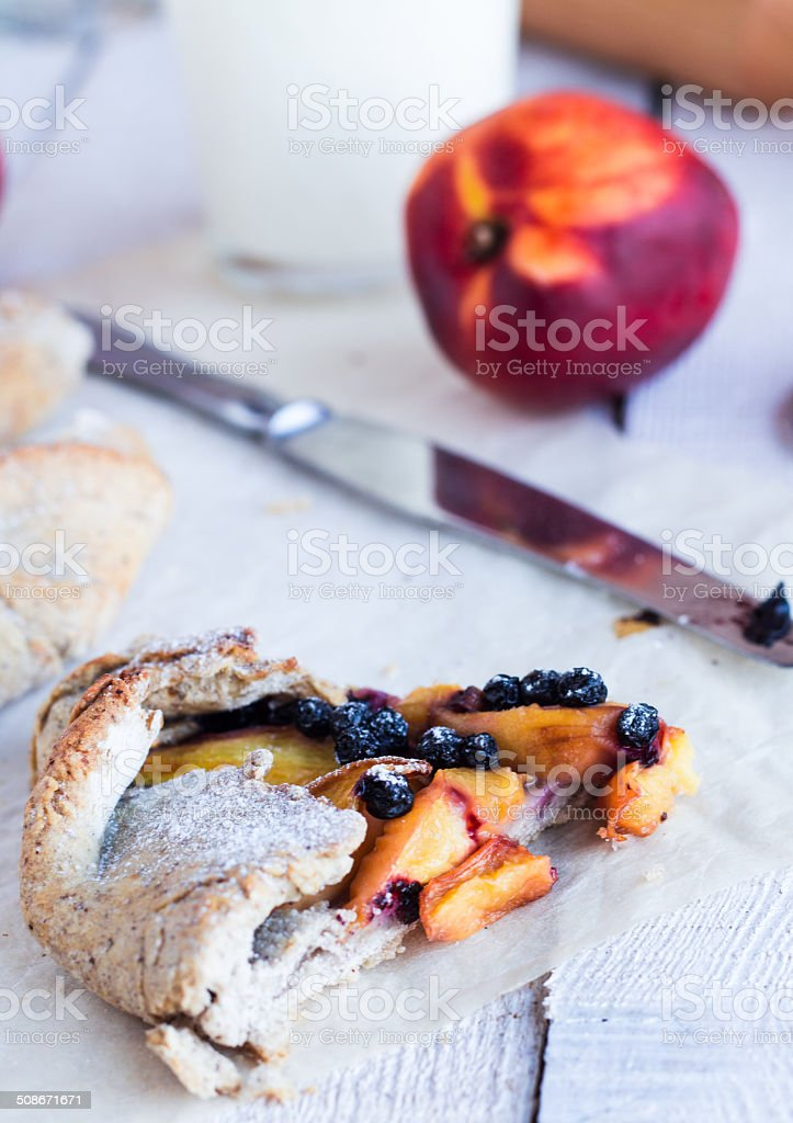cut biscuits with peach and blueberry stock photo