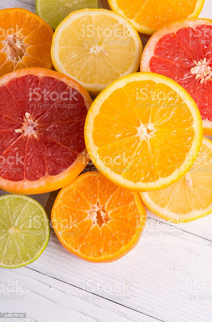 Cut citrus fruits on a background of white boards stock photo