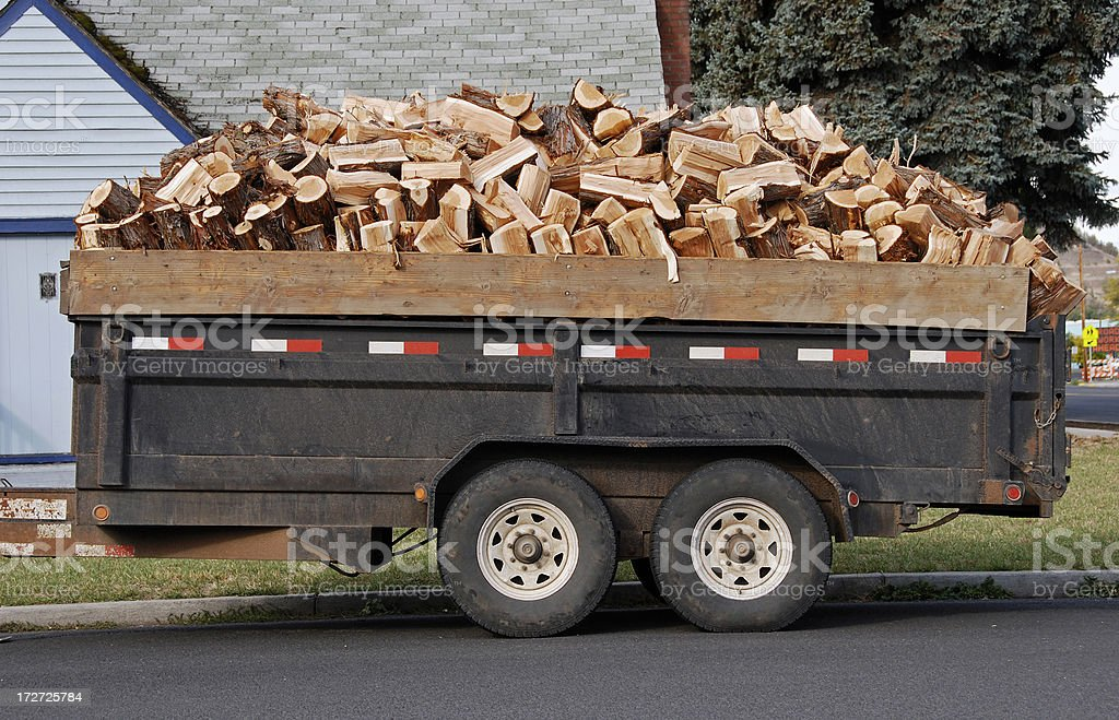 Cut fire wood in trailer royalty-free stock photo