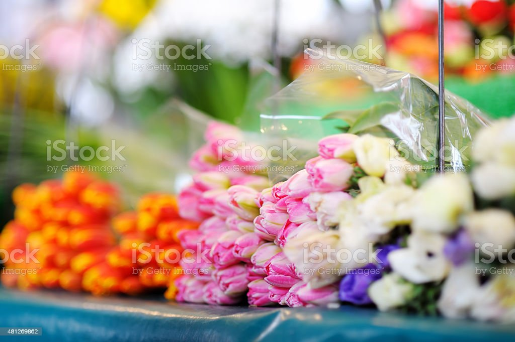 Cut flowers sold on outdoor flower shop stock photo