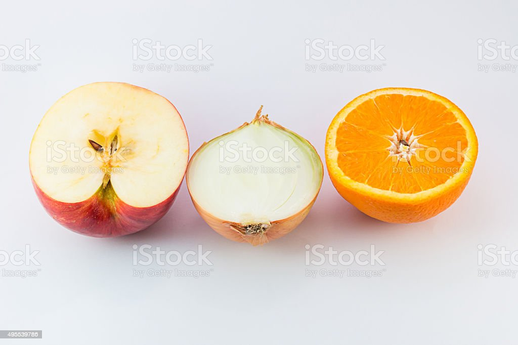 Cut fresh of apple, orange and onion. stock photo