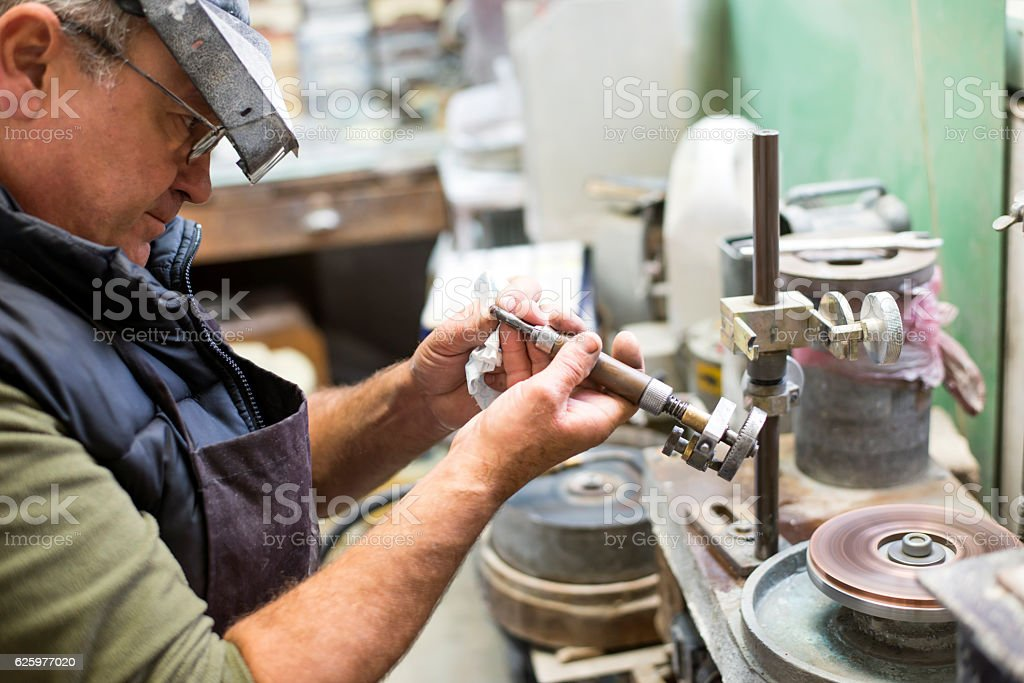 Cut gemstone,Faceting a Gemstone stock photo