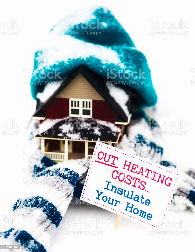 Cut Heating Costs; Insulate Your Home stock photo