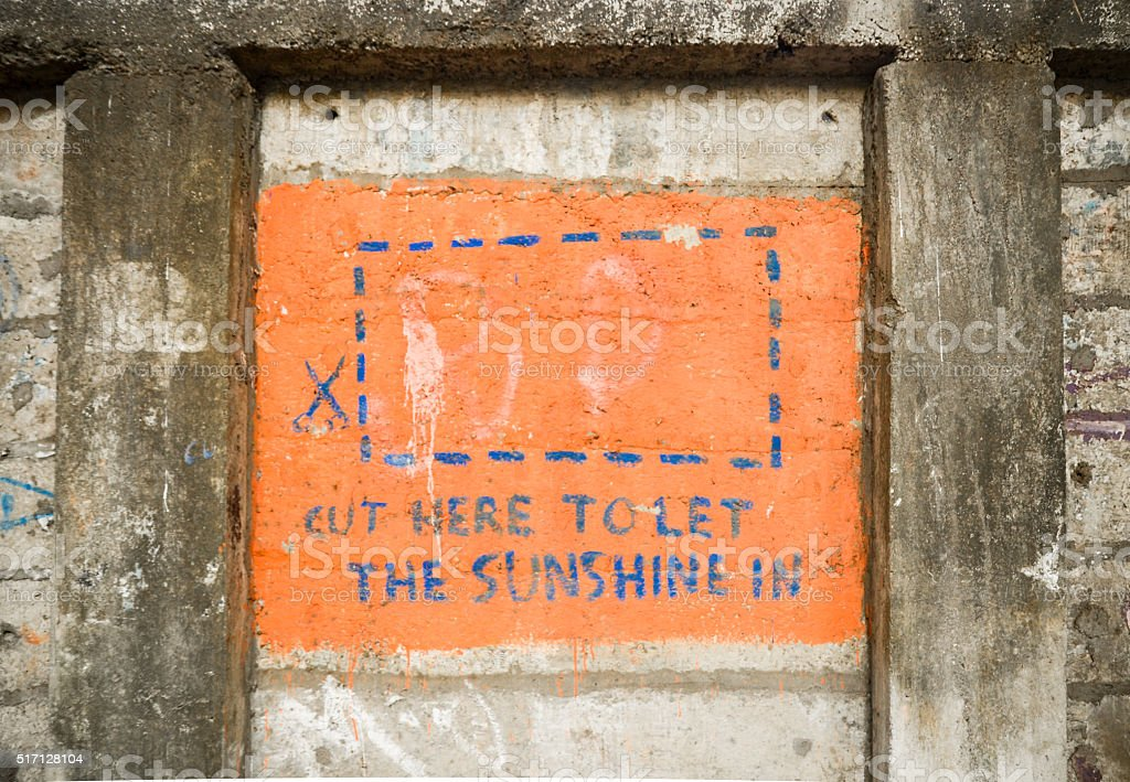 'Cut here to let the sunshine in' street art stock photo