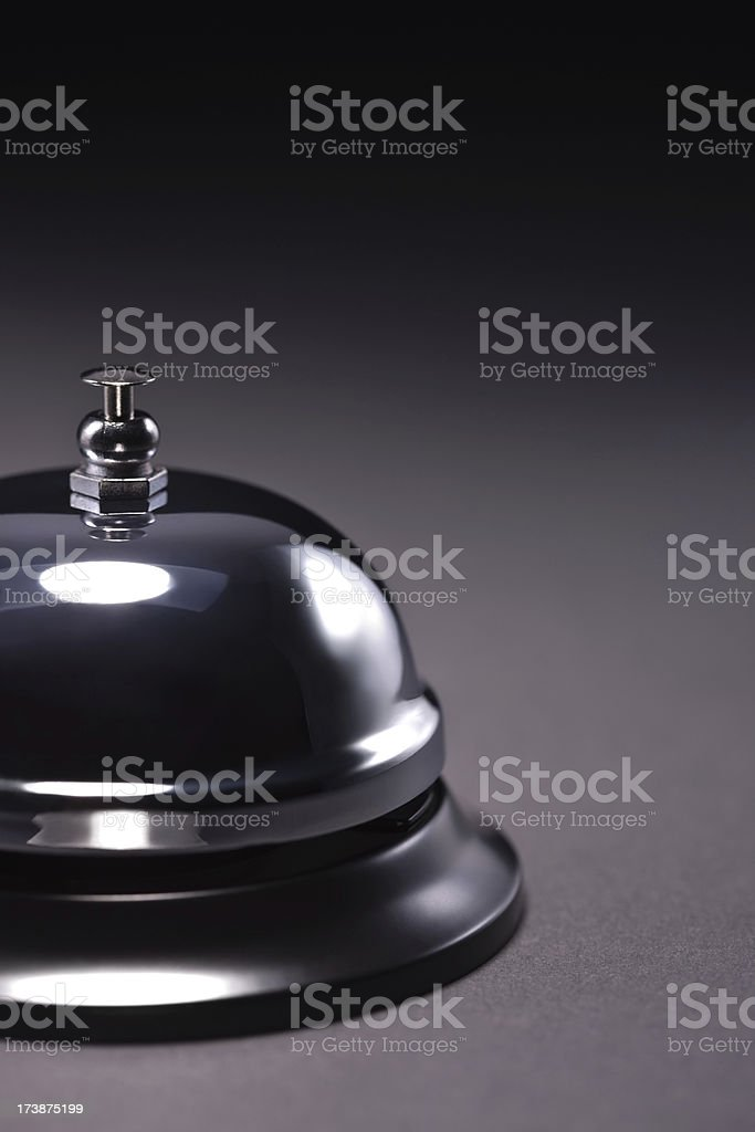 Cut image of a service bell over dark background royalty-free stock photo