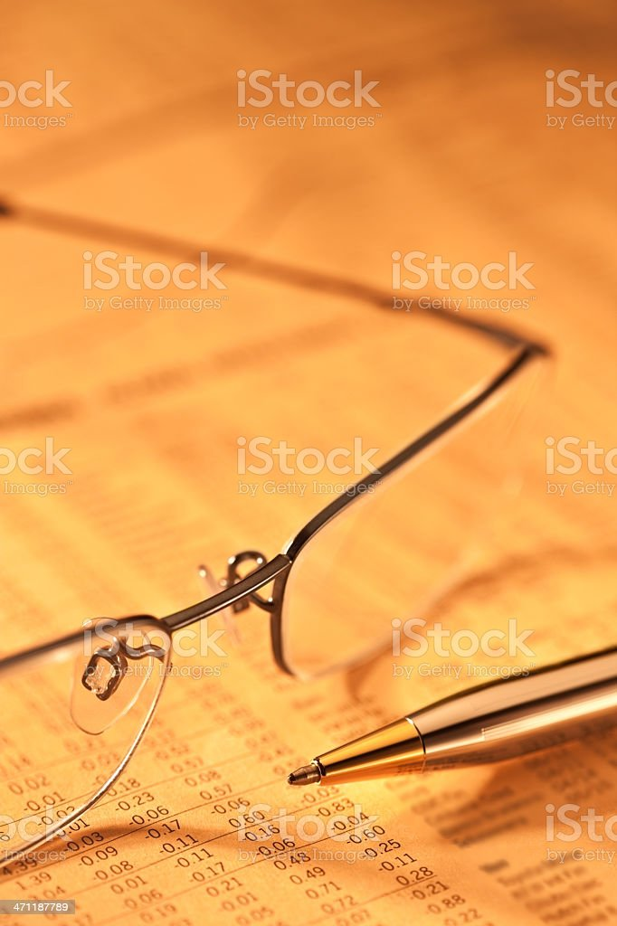 Cut image of spectacles and pen placed on paper royalty-free stock photo