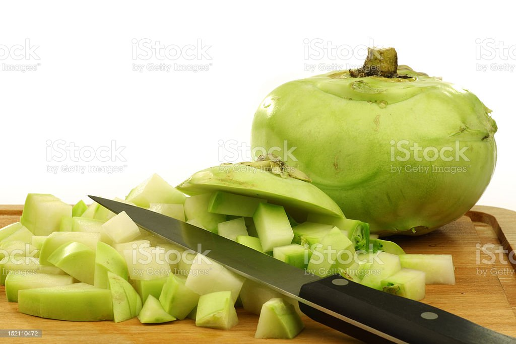 cut kohlrabi with a kitchen knife royalty-free stock photo
