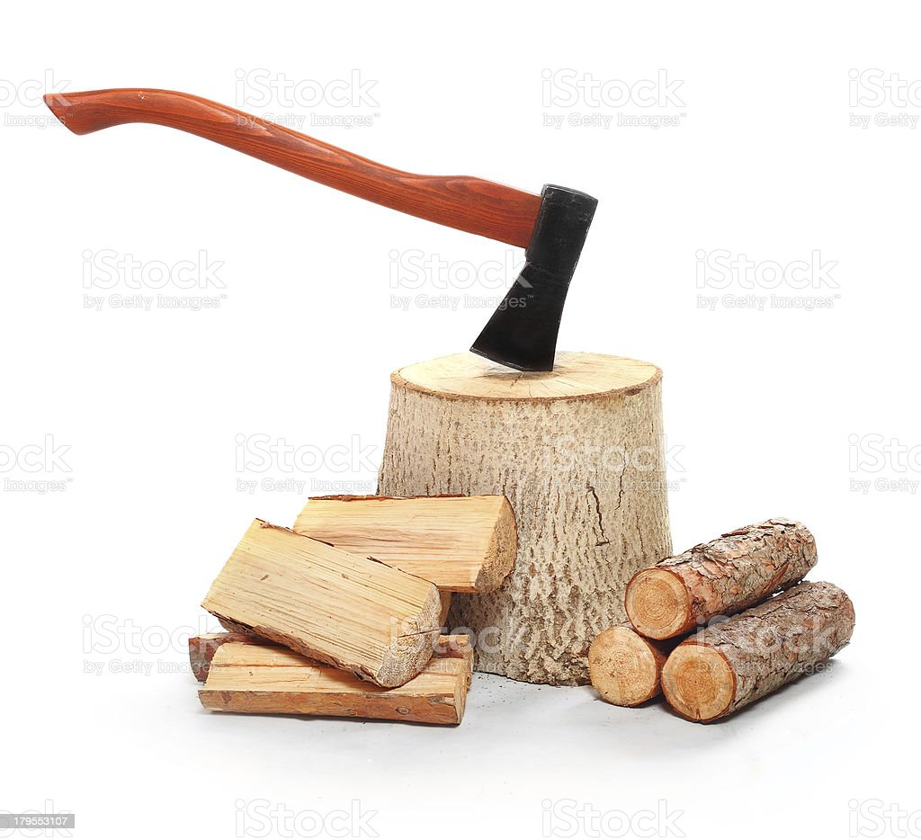 Cut logs fire wood and axe. royalty-free stock photo