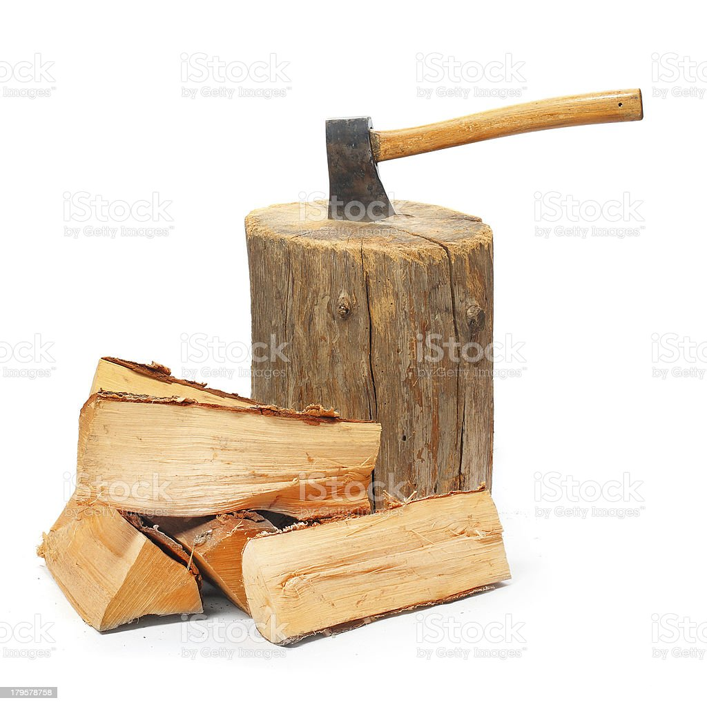 Cut logs fire wood and old axe. royalty-free stock photo