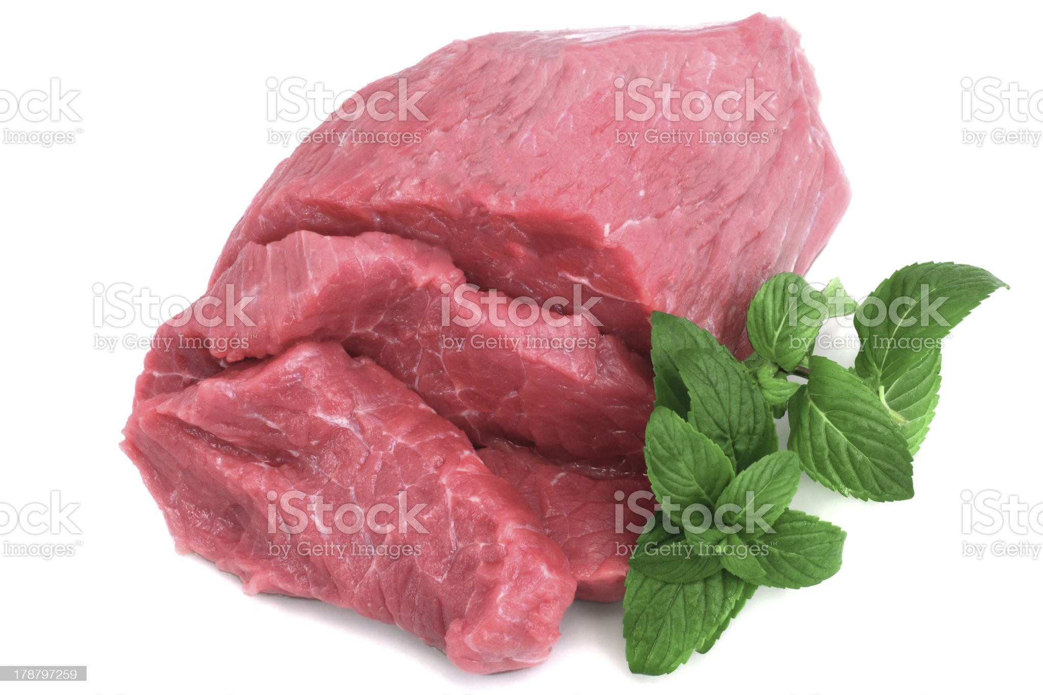 Cut of  beef steak with green leaf royalty-free stock photo