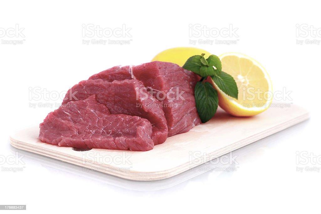 Cut of  beef steak with lemon slice royalty-free stock photo