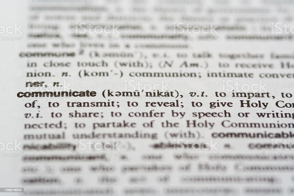 Cut of dictionary definition of communicate stock photo