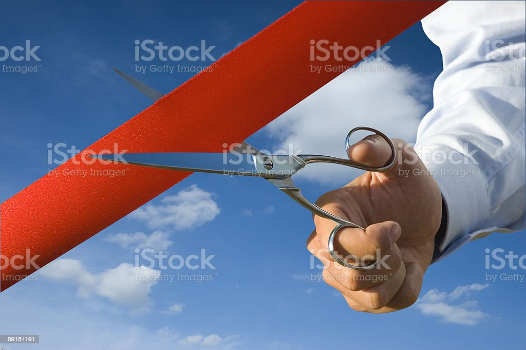 Cut of the red ribbon royalty-free stock photo