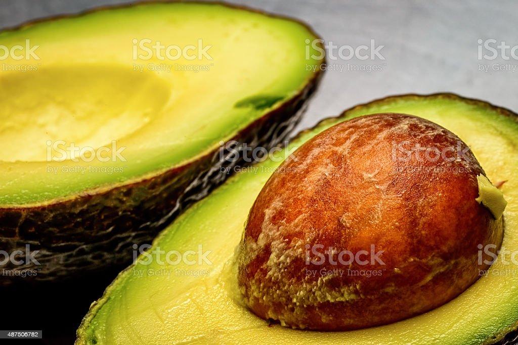 Cut open avocado stock photo