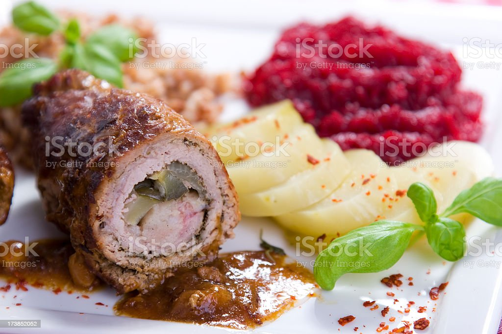 A cut open piece of beef roulades stock photo