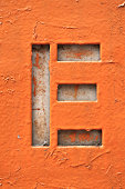 Cut out of the letter E in grunge style