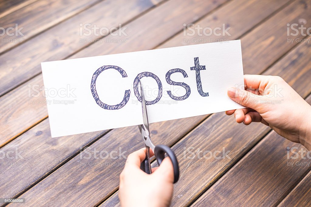 cut paper with word cost by scissors stock photo