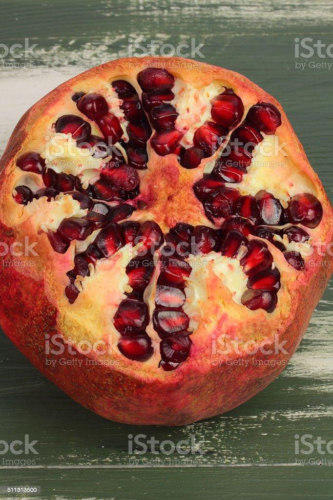 cut pomegranate helpful stock photo