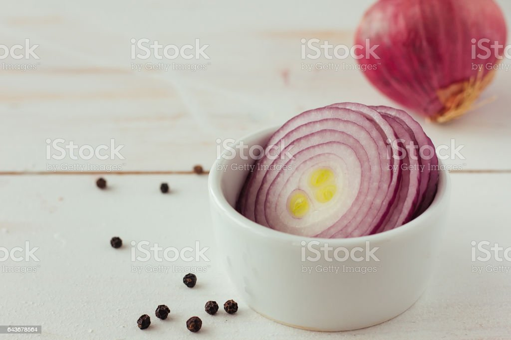 Cut red onion closeup stock photo