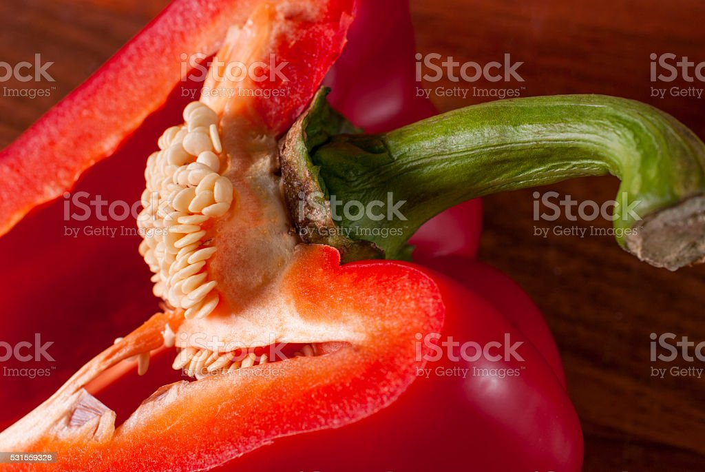 cut red pepper. Visible grains of pepper stock photo