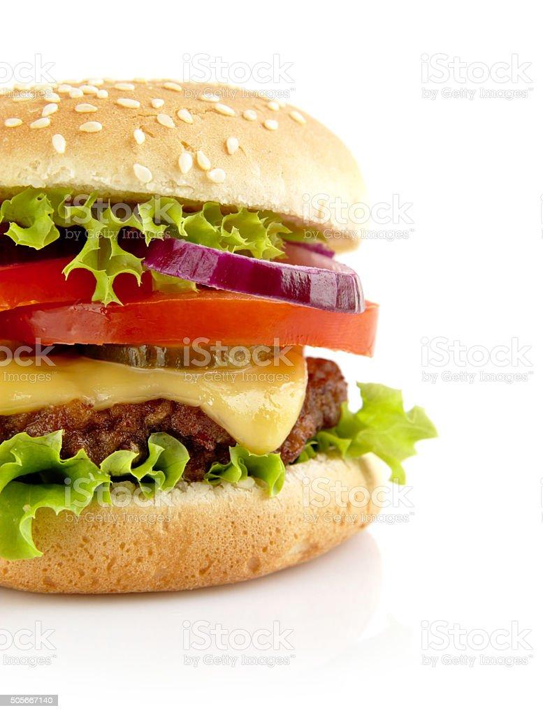 Cut shot of big cheeseburger isolated on white background stock photo