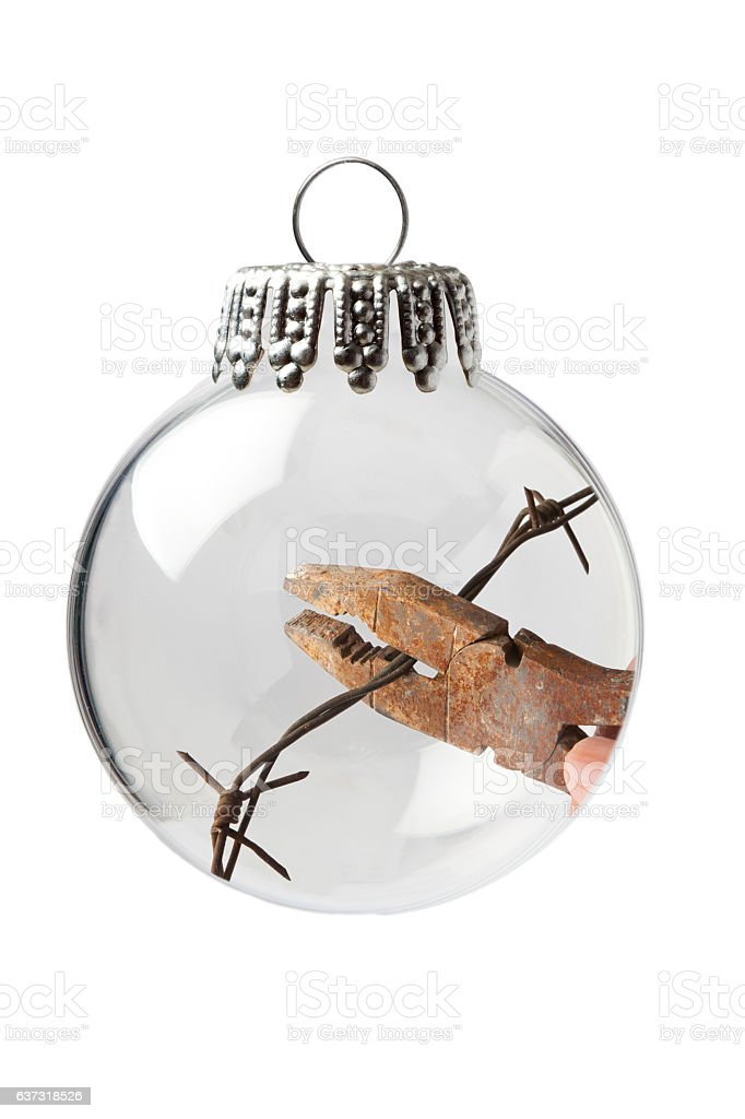 Cut the Barbed Wire in a Christmas Ornament stock photo