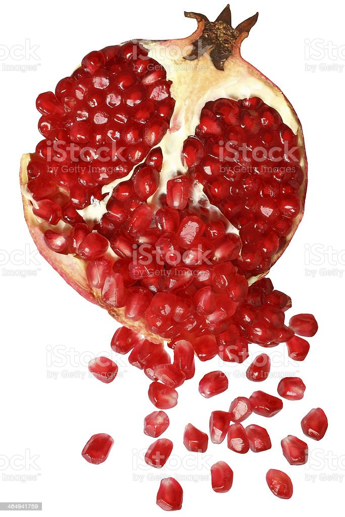 Cut the pomegranate with scattered grain top view stock photo
