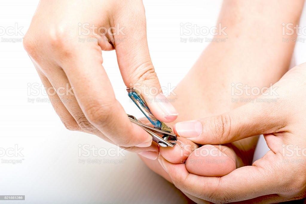 Cut toenails stock photo
