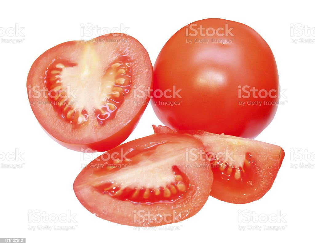 Cut tomatoes, isolated on white background royalty-free stock photo