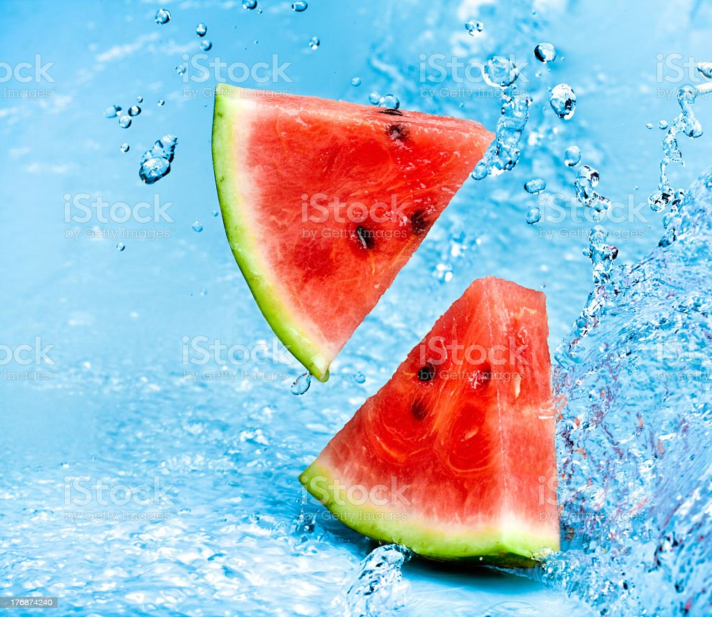 Cut up slices of watermelon against water royalty-free stock photo
