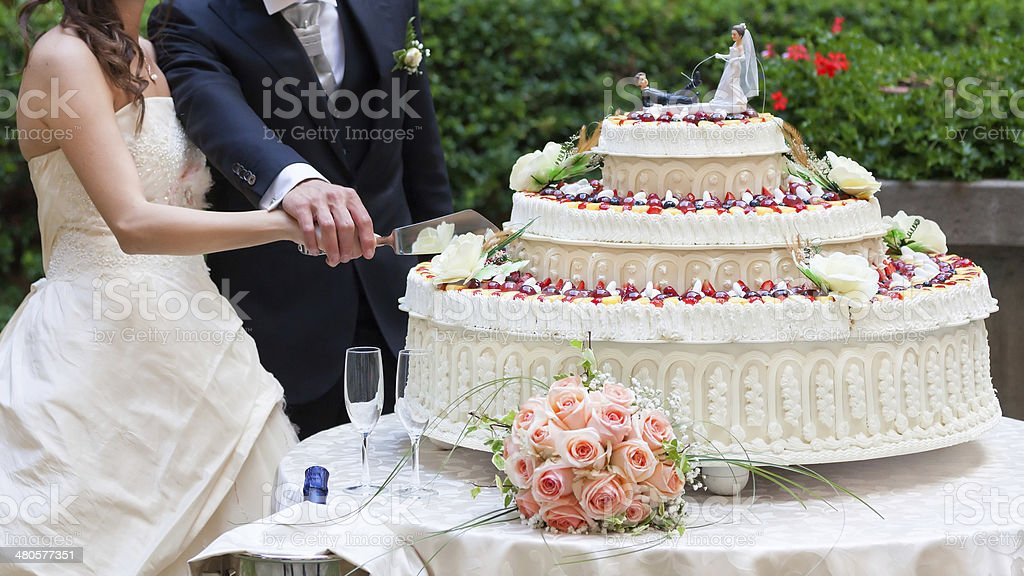 cut wedding cake stock photo