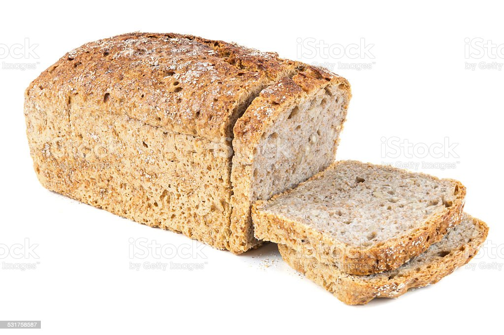 Cut wholemeal bread on white background stock photo
