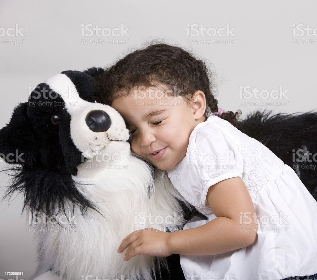 Cute 2 Year Old with her Dog royalty-free stock photo