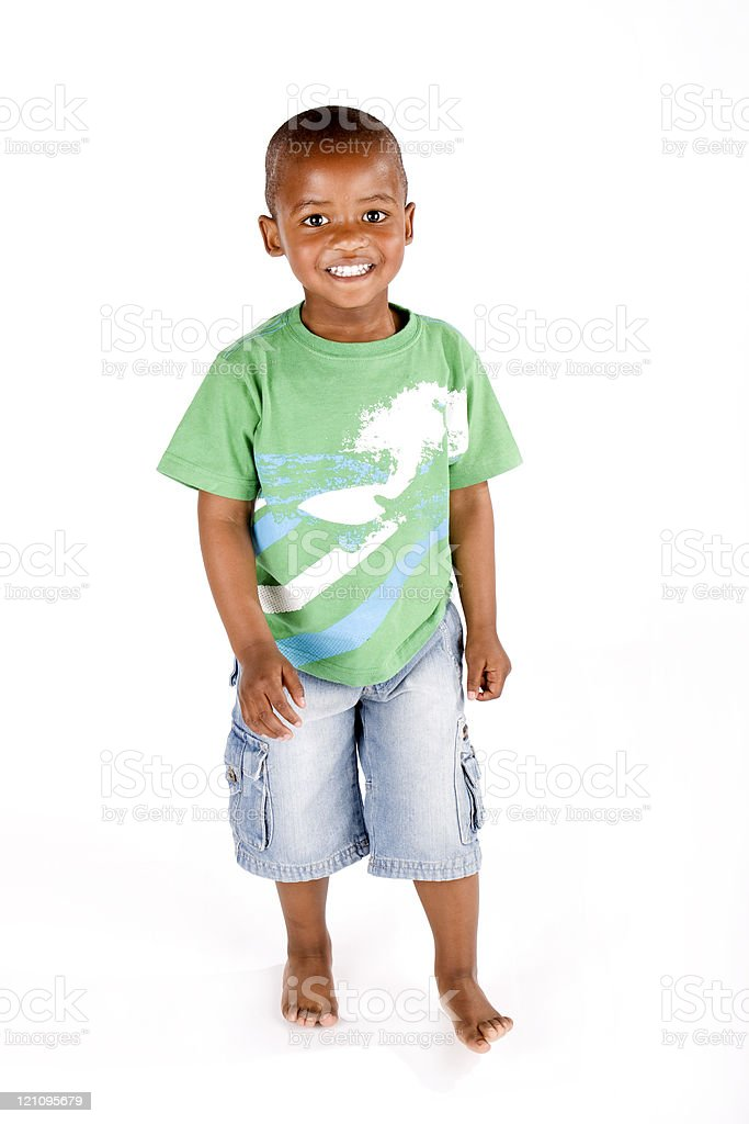 Cute 3 year old black boy standing and smiling stock photo