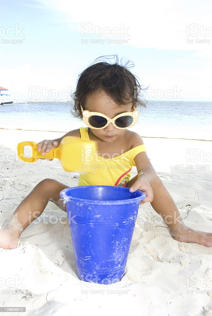 Cute 3 year old girl outside at the beach royalty-free stock photo