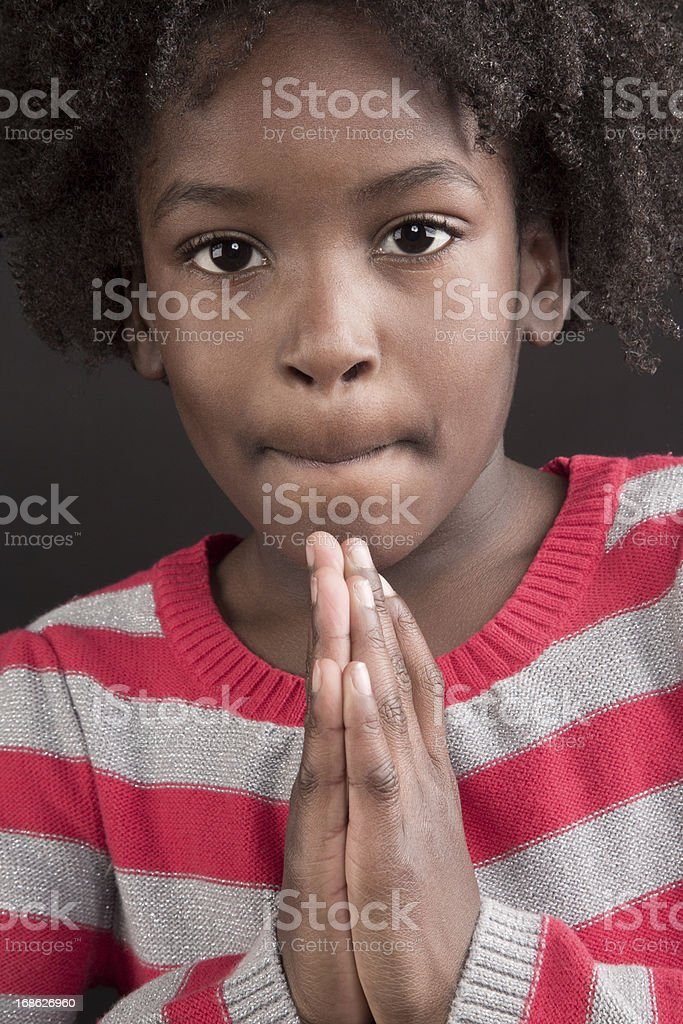 Cute 5 year old African American Girl Praying royalty-free stock photo