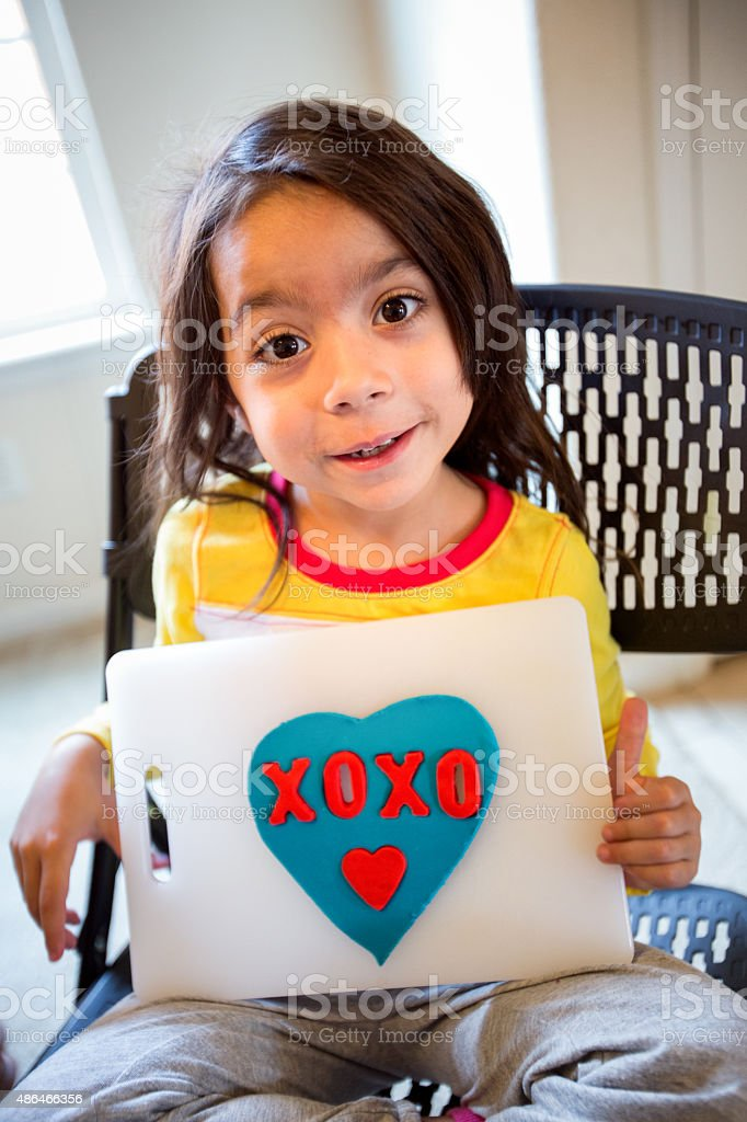 Cute 5 Year Old Girl with Clay Valentine stock photo