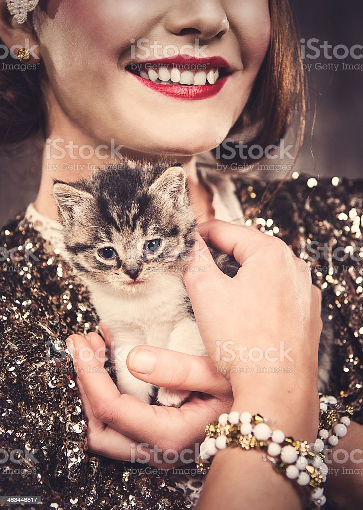 Cute 8 weeks old cat and beautiful woman stock photo